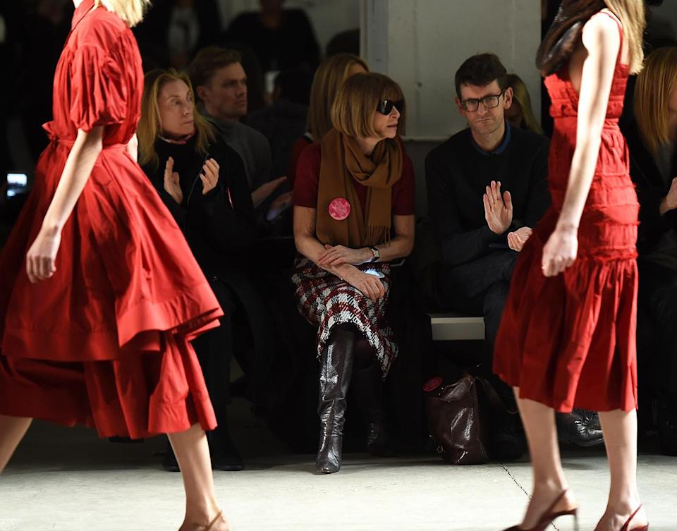 """<p>The Brock Collection gave show-goers a bright pink pin that reads """"Fashion Stands With Planned Parenthood"""" — and the most influential woman in fashion was spotted prominently wearing hers in the front row. (Photo by Nicholas Hunt/Getty Images for IMG) </p>"""