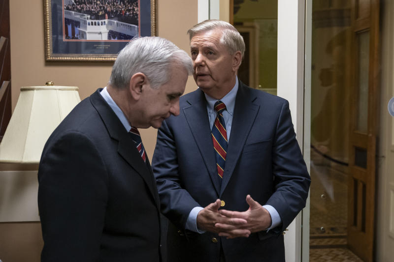 Sen. Jack Reed, D-R.I., left, and Sen. Lindsey Graham, R-S.C., members of the Senate Armed Services Committee, confer prior to a news conference to say they are disagreeing with President Donald Trump's sudden decision to pull all 2,000 U.S. troops out of Syria, at the Capitol in Washington, Thursday, Dec. 20, 2018. (AP Photo/J. Scott Applewhite)