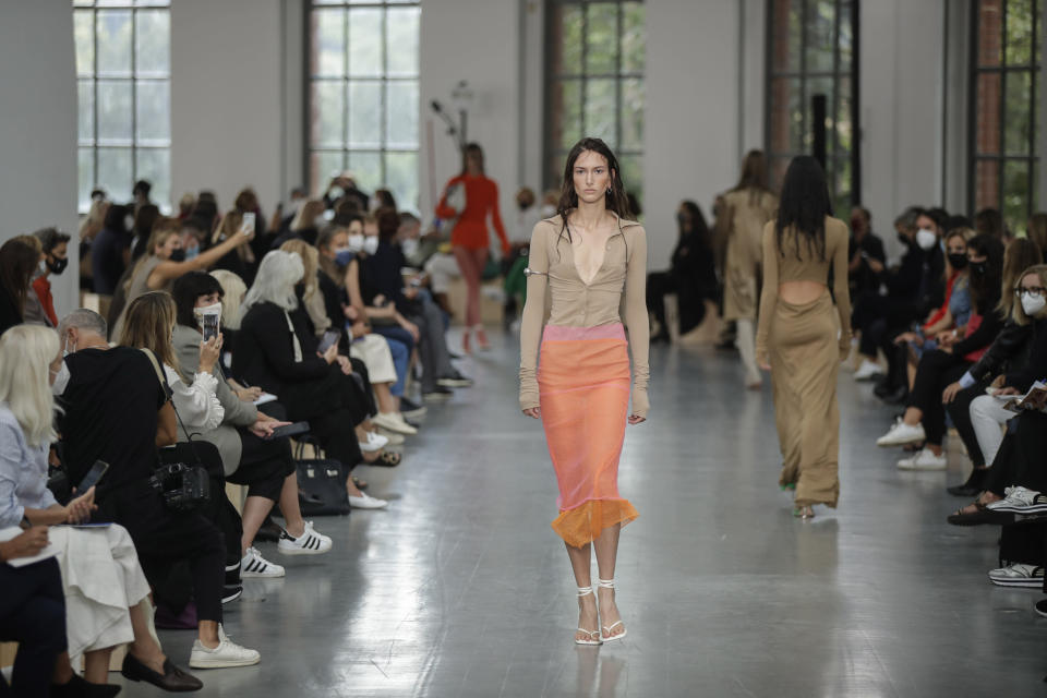 A model wears a creation as part of the Sportmax 2021 women's spring-summer ready-to-wear collection during the Milan's fashion week in Milan, Italy, Friday, Sept. 25, 2020. (AP Photo/Luca Bruno)