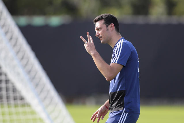 Argentina's coach Lionel Scaloni gestures to players during a Copa America's training session in Porto Alegre, Brazil, Monday, June 24, 2019. (AP Photo/Edison Vara)