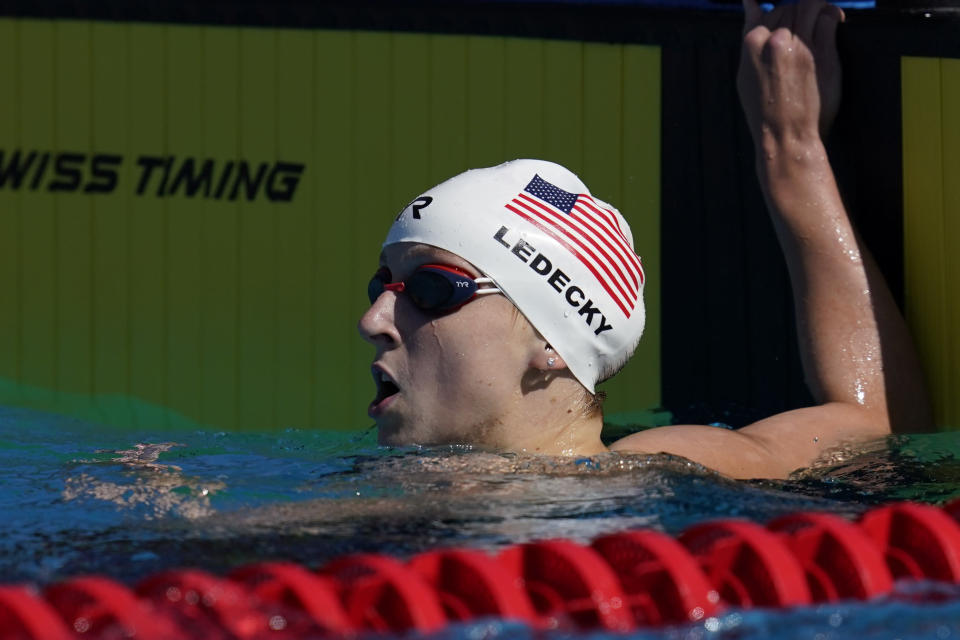 Katie Ledecky looks at the results after competing in the women's 200-meter final at the TYR Pro Swim Series swim meet Friday, April 9, 2021, in Mission Viejo, Calif. Ledecky won the final. (AP Photo/Ashley Landis)