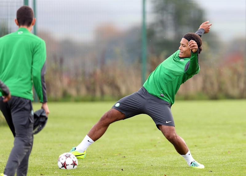 Celtic player Virgil Van Dijk (R) takes part in a training session at the Lennoxtown Training facility near Glasgow on October 21, 2013