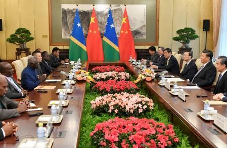 Solomon Islands Prime Minister Manasseh Sogavare speaks with Chinese President Xi Jinping during their meeting at the Diaoyutai State Guesthouse in Beijing
