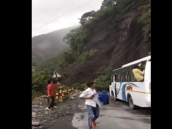 Passengers escaping from the bus. (Photo/ANI)
