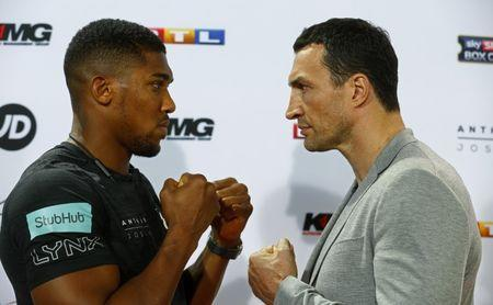 Boxing - Anthony Joshua & Wladimir Klitschko Press Conference - RTL, Cologne, Germany - 16/2/17 Anthony Joshua and Wladimir Klitschko pose during the press conference Reuters / Ralph Orlowski Livepic