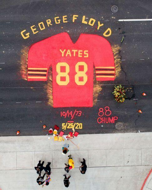PHOTO: Part of the mural by Third Ward native Jonah Elijah in honor of Black History Month and George Floyd is placed in front of Jack Yates High School in Houston, Texas, Feb. 6, 2021. (Elizabeth Conley/Houston Chronicle via AP)