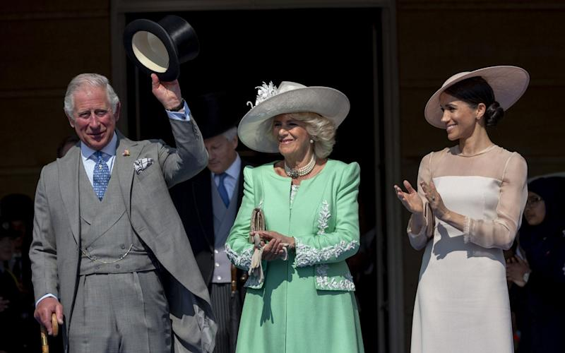 The Prince of Wales, Duchess of Cornwall and Duchess of Sussex during the Prince's 70th Birthday Patronage Celebration at Buckingham Palace on May 22, 2018  - UK Press