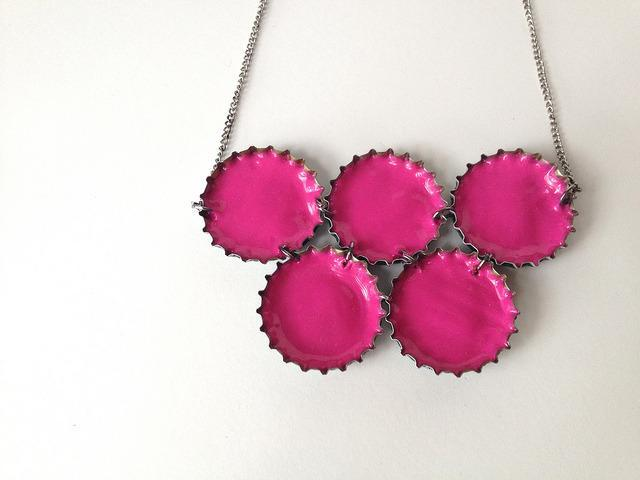 """<p>Here's another upcycled jewelry idea with a much different aesthetic. This idea is to fill bottle caps with neon fabric paint and cluster them together (or string one individually if that's more your style) for a pop-of-color statement necklace. Follow the steps outlined <a href=""""http://www.makermama.com/2012/10/upcycled-neon-necklace.html"""" rel=""""nofollow noopener"""" target=""""_blank"""" data-ylk=""""slk:here"""" class=""""link rapid-noclick-resp"""">here </a>to make yours. (Photo: <a href=""""http://www.makermama.com/2012/10/upcycled-neon-necklace.html"""" rel=""""nofollow noopener"""" target=""""_blank"""" data-ylk=""""slk:Maker Mama"""" class=""""link rapid-noclick-resp"""">Maker Mama</a>)</p>"""