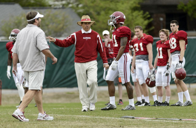 Alabama head coach Nick Saban gives feedback during an NCAA college spring football practice, Monday, April 7, 2014, in Tuscaloosa, Ala. (AP Photo/AL.com, Vasha Hunt)
