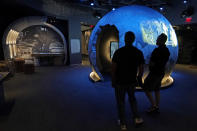 People view an exhibit on the Cold War during a tour of the Harry S. Truman Presidential Library and Museum Wednesday, June 9, 2021, in Independence, Mo. The facility will reopen July 2 after a nearly $30 million renovation project. (AP Photo/Charlie Riedel)