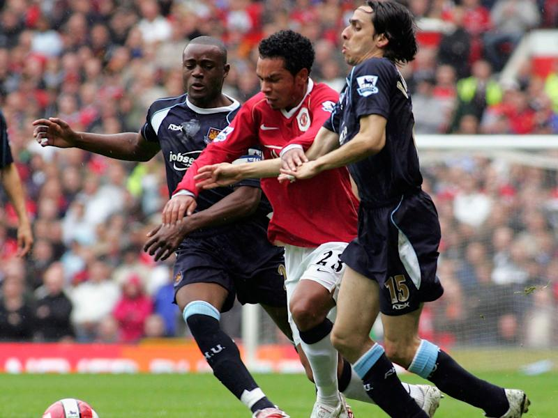 Nigel Reo-Coker and Kieran Richardson do battle in a previous life: Getty