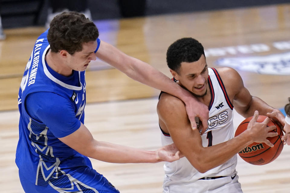 Gonzaga guard Jalen Suggs (1) wins a loose ball from Creighton center Ryan Kalkbrenner (32) in the second half of a Sweet 16 game in the NCAA men's college basketball tournament at Hinkle Fieldhouse in Indianapolis, Sunday, March 28, 2021. (AP Photo/AJ Mast)