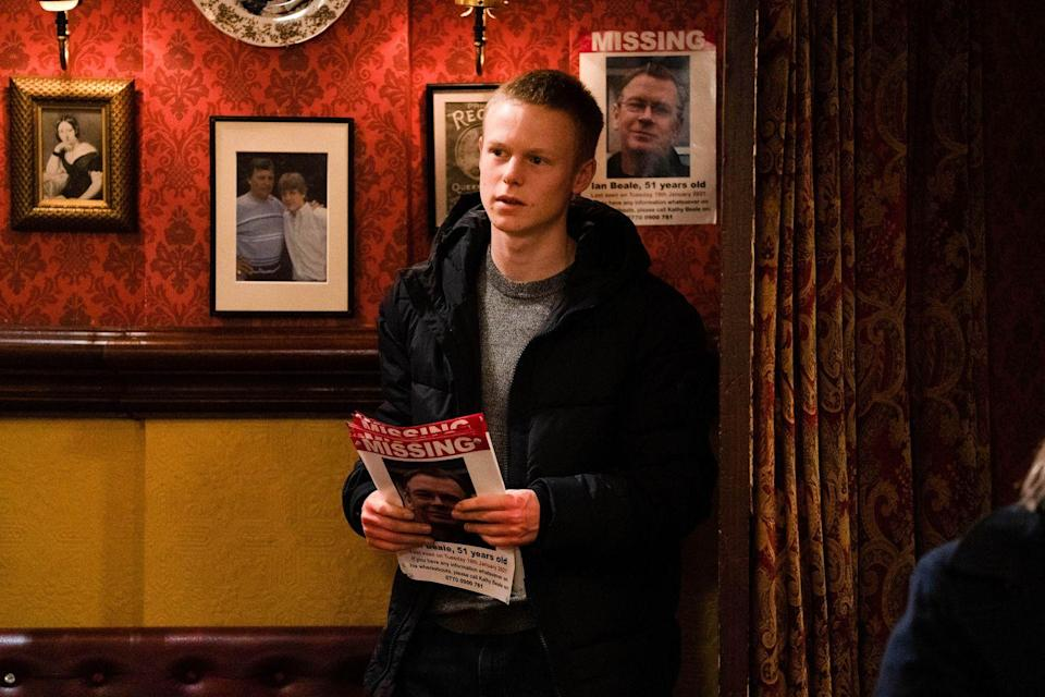 <p>Bobby puts up 'missing' posters around Walford.</p>