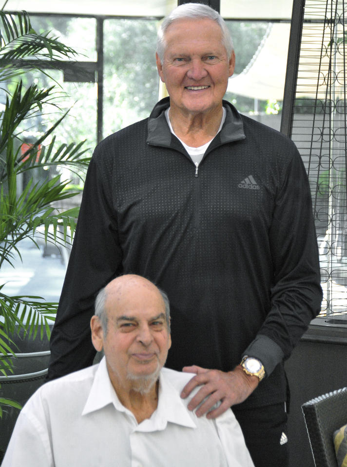 This October 2015 photo provided by the Culver City Observer shows veteran sports writer and columnist Mitch Chortkoff, seated, and Los Angeles Lakers great Jerry West in Los Angeles. Chortkoff, who covered the Lakers and other sports for more than 50 years, has died. He was 78. Chortkoff died Tuesday, July 17, 2018, at a health care facility in Los Angeles following a long illness, according to his brother Stan. Chortkoff was considered the dean of the Lakers' press corps, having begun coverage of the team in the early 1960s, shortly after they arrived from Minneapolis. (George Laase/Culver City Observer via AP)