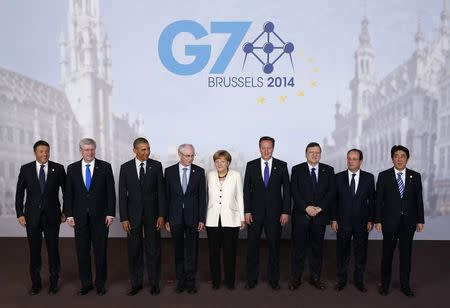 Leaders pose for a family photo at the G7 summit in Brussels June 5, 2014. From left: Italy's Prime Minister Matteo Renzi, Canada's Prime Minister Stephen Harper, U.S. President Barack Obama, European Council President Herman Van Rompuy, German Chancellor Angela Merkel, Britain's Prime Minister David Cameron, European Commission President Jose Manuel Barroso, France's President Francois Hollande and Japan's Prime Minister Shizo Abe.   REUTERS/Kevin Lamarque
