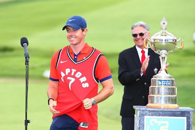 Rory McIlroy wears a Toronto Raptors jersey to celebrate his Canadian Open victory (AFP Photo/Vaughn Ridley)