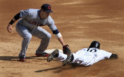 Cleveland Indians' Jason Kipnis, left, tags out Chicago White Sox's Alexei Ramirez while attempting to steal second base during the third inning of a baseball game, Tuesday, Sept. 25, 2012, in Chicago. (AP Photo/John Smierciak)