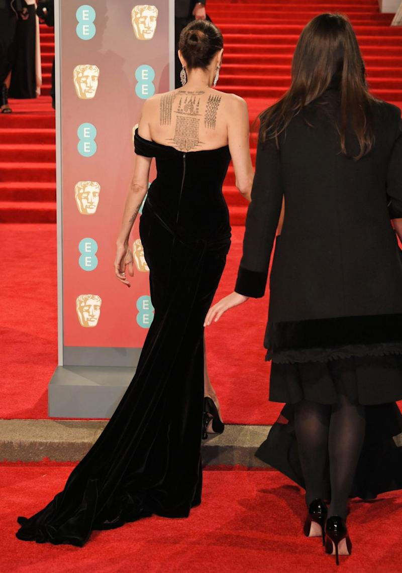 With her hair pulled back in a slick bun, Ange revealed her famous tattoos splashed across her back. Source: Getty