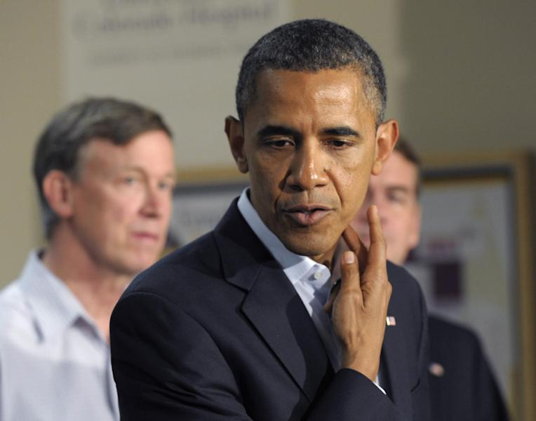 President Barack Obama talks about one of the victims and her injury during a statement from the University of Colorado Hospital in Aurora, Colo., Sunday, July 22, 2012, after visiting with families of victims of the movie theater shooting as well as local officials. Colorado Gov. John Hickenlooper is at left. (AP Photo/Susan Walsh)