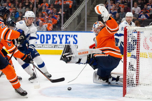 Edmonton Oilers goaltender Mikko Koskinen (19) makes a save against Tampa Bay Lightning defenseman Mikhail Sergachev (98) during the first period of an NHL hockey game Saturday, Dec. 22, 2018, in Edmonton, Alberta. (Codie McLachlan/The Canadian Press via AP)