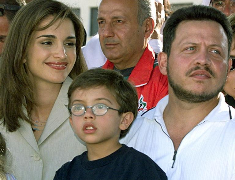 Jordan's King Abdullah II, his wife Queen Rania, and their son Prince Hussein attend an equestrian competition in Amman in 1999