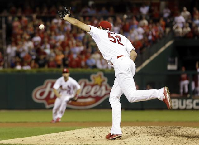 St. Louis Cardinals starting pitcher Michael Wacha cannot reach an infield single by Washington Nationals' Ryan Zimmerman with two outs during the ninth inning, breaking up Wacha's no-hitter in a baseball game Tuesday, Sept. 24, 2013, in St. Louis. The Cardinals won 2-0. (AP Photo/Jeff Roberson)