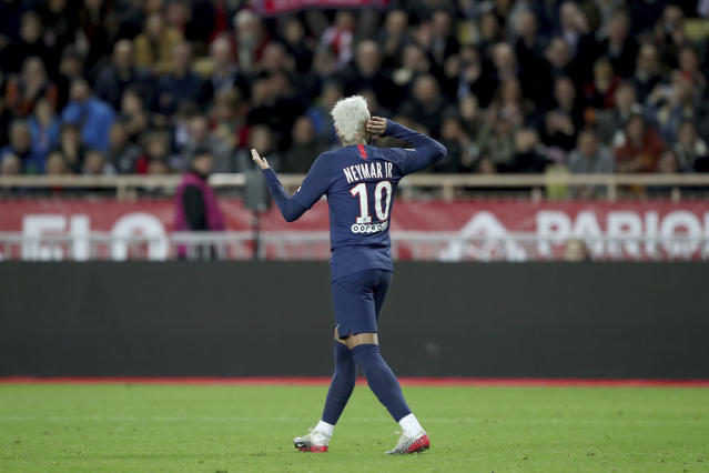 PSG's Neymar celebrates after scoring his side's second goal during the French League One soccer match between Monaco and Paris Saint-Germain at the Louis II stadium in Monaco, Wednesday, Jan. 15, 2019. (AP Photo/Daniel Cole)