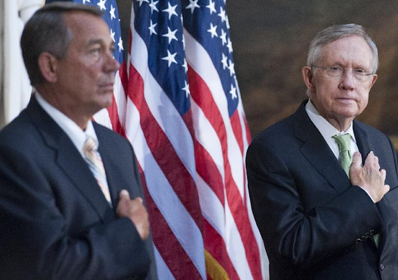 Speaker of the House John Boehner (L) and Senate Majority Leader Harry Reid stand during the National Anthem during a ceremony to posthumously present a Congressional Gold Medal to Raoul Wallenberg at the US Capitol in Washington, DC, July 9, 2014 (AFP Photo/Saul Loeb)