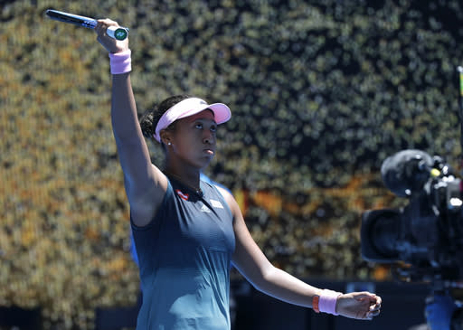 Japan's Naomi Osaka celebrates after defeating Latvia's Anastasija Sevastova during their fourth round match at the Australian Open tennis championships in Melbourne, Australia, Monday, Jan. 21, 2019. (AP Photo/Kin Cheung)