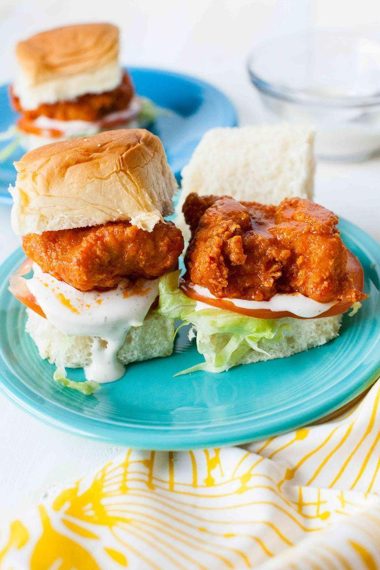 """<p>Buffalo chicken and game day go hand in hand. These sliders are great for treating your entire crew on Super Bowl Sunday.</p><p><strong><a href=""""https://www.thepioneerwoman.com/food-cooking/recipes/a85040/buffalo-chicken-sliders/"""" rel=""""nofollow noopener"""" target=""""_blank"""" data-ylk=""""slk:Get the recipe."""" class=""""link rapid-noclick-resp"""">Get the recipe.</a></strong></p><p><a class=""""link rapid-noclick-resp"""" href=""""https://go.redirectingat.com?id=74968X1596630&url=https%3A%2F%2Fwww.walmart.com%2Fbrowse%2Fhome%2Fthe-pioneer-woman-plates%2F4044_623679_639999_2113437_9360029&sref=https%3A%2F%2Fwww.thepioneerwoman.com%2Ffood-cooking%2Fmeals-menus%2Fg35049189%2Fsuper-bowl-food-recipes%2F"""" rel=""""nofollow noopener"""" target=""""_blank"""" data-ylk=""""slk:SHOP PLATES"""">SHOP PLATES</a></p>"""