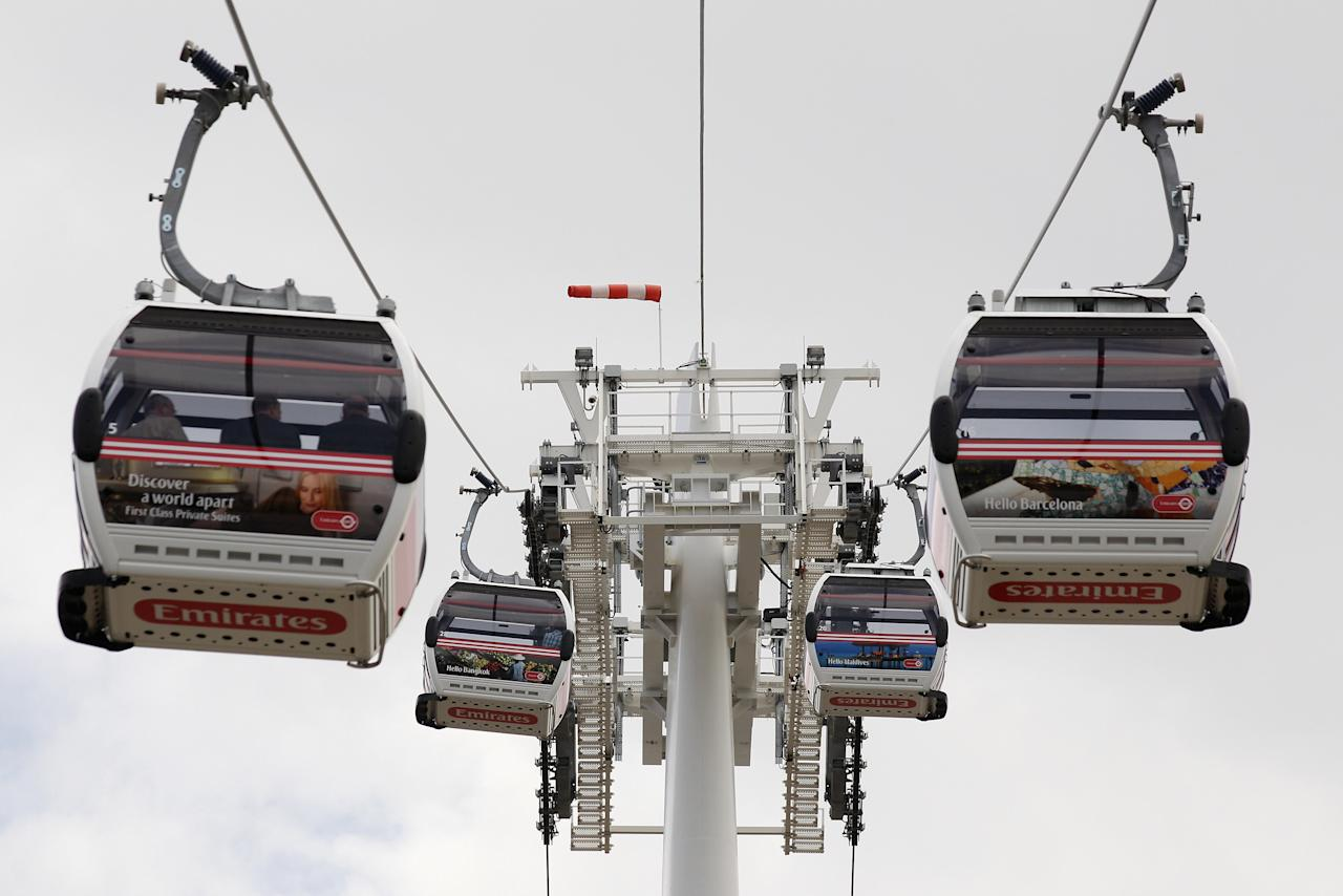The newly opened Emirates Air Line cable car, which operates between the O2 Arena in Greenwich and the ExCeL exhibition centre, at the Royal Docks on June 28, 2012 in London, England. The service crosses the Thames at a speed of 8.9 miles per hour and at a height of almost 300ft; is capable if carrying up to 2,500 people per hour.  (Photo by Oli Scarff/Getty Images)