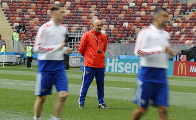 Russia coach Stanislav Cherchesov looks his players at the official training session of the Russian team one the eve of the group A match between Russia and Saudi Arabia at the 2018 soccer World Cup at Luzhniki stadium in Moscow, Russia, Wednesday, June 13, 2018. (AP Photo/Antonio Calanni)