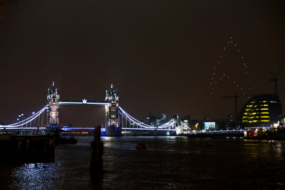 """Another view of the """"Star Trek"""" logo in the London skies, which a fleet of drones created on March 23, 2013 to mark """"Earth hour"""" and promote the upcoming film """"Star Trek: Into Darkness."""" London's iconic Tower Bridge is at left."""