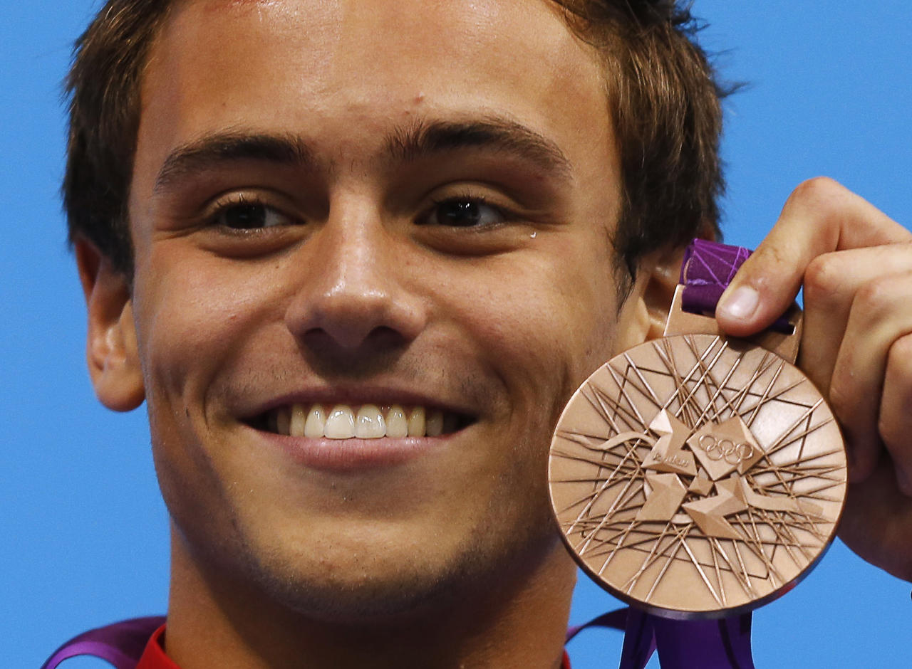 Britain's Tom Daley poses with his bronze medal during the men's 10m platform victory ceremony at the London 2012 Olympic Games at the Aquatics Centre August 11, 2012.       REUTERS/Tim Wimborne (BRITAIN  - Tags: SPORT DIVING OLYMPICS)