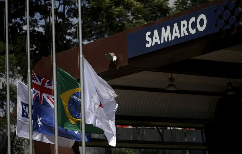 FILE PHOTO: An Australian and a Brazilian flags are pictured on the entrance of the mine operator Samarco owned by Vale SA and BHP Billiton Ltd in Mariana