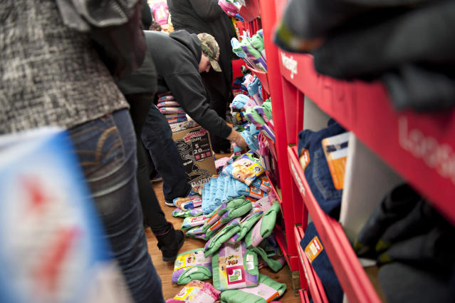 People rifle through a bin of Black Friday-priced children's pajamas at a Walmart store in Ohioin 2011. (Bloomberg via Getty Images)