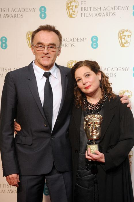 Tessa Ross, winner of the Outstanding British Contribution To Cinema award, poses in the press room with presenter Danny Boyle at the EE British Academy Film Awards at The Royal Opera House on February 10, 2013 in London, England. (Photo by Stuart Wilson/Getty Images)