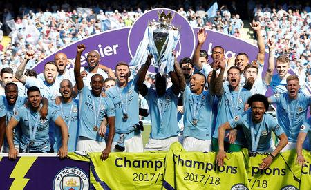 FILE PHOTO: Soccer Football - Premier League - Manchester City vs Huddersfield Town - Etihad Stadium, Manchester, Britain - May 6, 2018   Manchester City celebrate with the trophy after winning the Premier League title   REUTERS/Phil Noble/File Photo