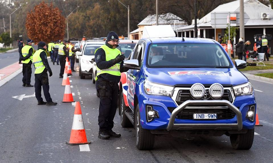 Police in the southern New South Wales border city of Albury check cars crossing the state border from Victoria. Source: AAP