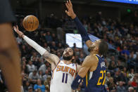 Phoenix Suns guard Ricky Rubio (11) goes to the basket as Utah Jazz center Rudy Gobert (27) defends in the second half during an NBA basketball game Monday, Feb. 24, 2020, in Salt Lake City. (AP Photo/Rick Bowmer)