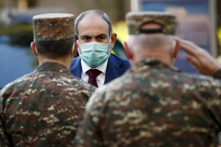 In this photo provided by the Armenian Prime Minister Press Service via PAN Photo, Armenian Prime Minister Nikol Pashinyan arrives to visit a military hospital in Yerevan, Armenia, Friday, Oct. 23, 2020. Heavy fighting is raging over Nagorno-Karabakh even as top diplomats from Armenia and Azerbaijan have traveled to Washington for negotiations on settling the neighboring countries' decades-long conflict. (Tigran Mehrabyan, Armenian Prime Minister Press Service/PAN Photo via AP)