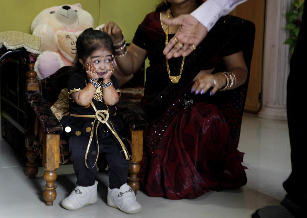 Relatives congratulate Indian Jyoti Amge, 18, who stands at 61.95 centimeters (2 feet), before a press conference with Guinness World Records in Nagpur, India, Friday, Dec. 16, 2011. Officials from Guinness were expected to measure Amge later Friday and declare her the World's Shortest Woman. (AP Photo/Manish Swarup)