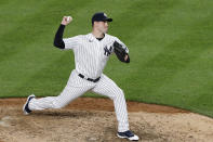 New York Yankees relief pitcher Adam Ottavino winds up during the eighth inning of the team's baseball game against the Boston Red Sox, Sunday, Aug. 2, 2020, at Yankee Stadium in New York. (AP Photo/Kathy Willens)
