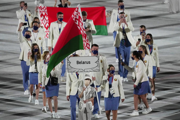 Athletes from Belarus walk during the opening ceremony in the Olympic Stadium at the 2020 Summer Olympics, Friday, July 23, 2021, in Tokyo, Japan. (AP Photo/David J. Phillip)