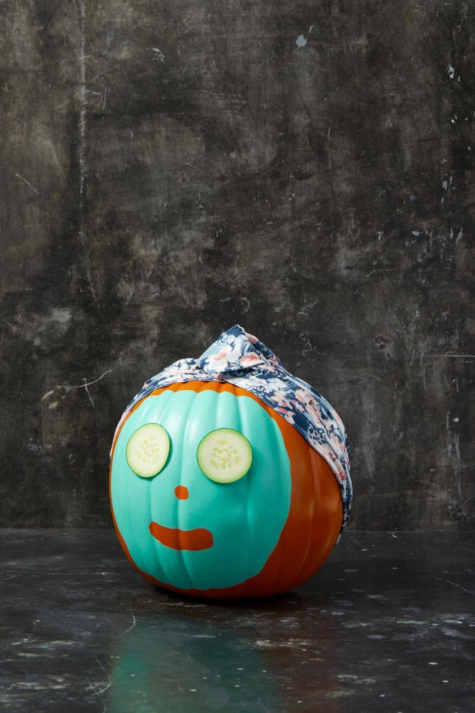 """<p>To make this spa-going pumpkin face, simply paint a """"face mask"""" onto a real or faux pumpkin, leaving spaces for the nose and mouth. Let it dry completely. Then, stretch a decorative shower cap onto the pumpkin's """"head"""" and pin it in place with straight pins. To make the cucumber eyes, just print images of cucumbers from a picture online and glue them on. </p><p><strong>RELATED:</strong> <a href=""""https://www.goodhousekeeping.com/holidays/halloween-ideas/g2592/pumpkin-painting-ideas/"""" rel=""""nofollow noopener"""" target=""""_blank"""" data-ylk=""""slk:30+ Pumpkin Painting Ideas for a Fun Halloween"""" class=""""link rapid-noclick-resp"""">30+ Pumpkin Painting Ideas for a Fun Halloween</a></p>"""