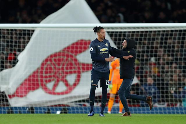 An Arsenal fan ran onto the pitch and shoved Manchester United's Chris Smalling on Sunday in another ugly incident. (Getty)