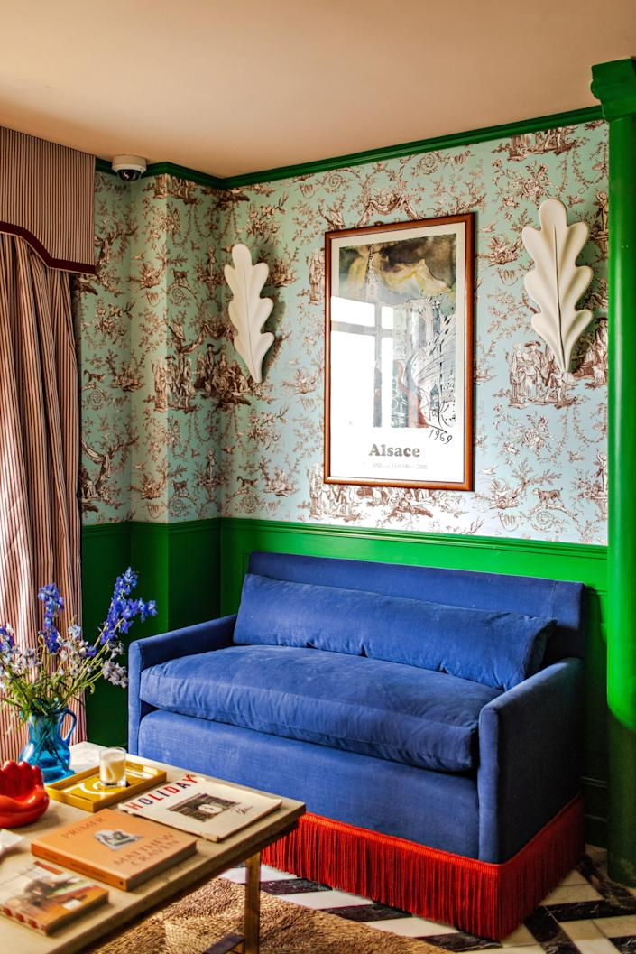 """<p><strong>Set the scene:</strong> On a quiet backstreet of <a href=""""https://www.cntraveler.com/destinations/paris?mbid=synd_yahoo_rss"""" rel=""""nofollow noopener"""" target=""""_blank"""" data-ylk=""""slk:Paris's"""" class=""""link rapid-noclick-resp"""">Paris's</a> bustling Little India, where the sweet scent of curries simmering in restaurant kitchens hangs in the air, is a six-story limestone corner building that glints in the stark white daylight. Trains rumble past below street level and pull into the Gare de l'Est, one of the city's oldest train stations (the Gare du Nord is just around the corner, hence the name). This is the first hotel designed by Luke Edward Hall, after the opening was delayed due to Covid; check in at the reception desk tucked behind a perspex screen before scurrying off to snap the bold-hued rooms for Insta Reels. The hotel has Hall's playful optimism splashed all over, putting the dismal weather outside, and the pandemic, on hold—at least for the night.</p> <p><strong>What's the story?</strong> When hotelier Adrien Gloaguen visited this faded station hotel, he saw the potential in the simple Haussmannian-style corner building overlooking the railway right away. With three other popular hotel locations in the city already (<a href=""""https://www.cntraveler.com/hotels/paris/hotel-panache?mbid=synd_yahoo_rss"""" rel=""""nofollow noopener"""" target=""""_blank"""" data-ylk=""""slk:Panache"""" class=""""link rapid-noclick-resp"""">Panache</a>, Beaurepaire, and <a href=""""https://www.cntraveler.com/hotels/paris/hotel-bienvenue-paris?mbid=synd_yahoo_rss"""" rel=""""nofollow noopener"""" target=""""_blank"""" data-ylk=""""slk:Bienvenue"""" class=""""link rapid-noclick-resp"""">Bienvenue</a>), Gloaguen was quick to snag one of the hottest designers of the moment, cleverly commissioning his first hotel project. Hall effortlessly flits between styles and patterns to create a color-splashed world that's theatrical and yet welcoming. Here, he aimed to create intrigue through a Brit-meets-French atmosphere: """"I wanted it to feel li"""