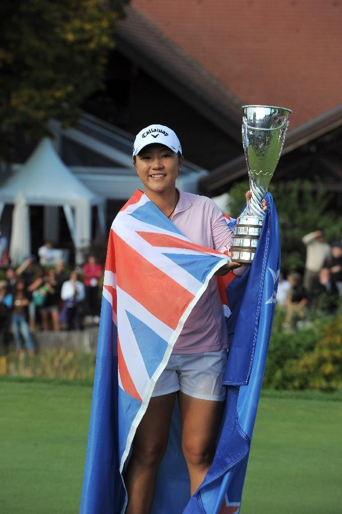 New Zealand's Lydia Ko poses with her trophy after winning the Evian Championship, in the French Alps town of Evian-les-Bains, on September 13, 2015 (AFP Photo/Jean-Pierre Clatot)