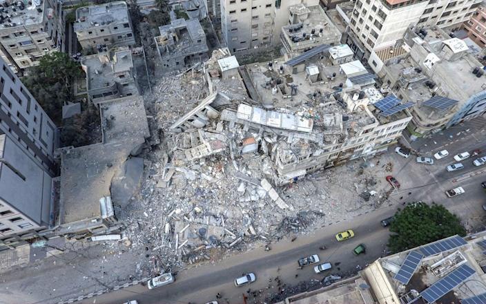 A drone photo of the remains of the 14-storey al-Shorouk tower, which housed local and foreign media outlets until it was destroyed in an Israeli airstrike - Ali Jadallah/Anadolu Agency