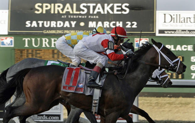 Jockey John Velazquez rides We Miss Artie (11) to a come-from-behind victory in the Spiral Stakes horse race at Turfway Park race track in Florence, Ky., Saturday, March 22, 2014. The victory gave Velazquez more than $300 million in earnings in his career, the first for any jockey. (AP Photo/Garry Jones)